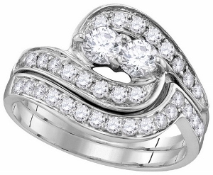1 ctw Diamond Bridal Set in 14 karat White Gold --This 1 carat total weight diamond bridal set expresses the harmony of union with a delicate intertwined two-stone diamond design in 14k white gold.