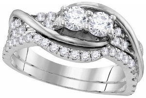1 ctw Diamond Bridal Set in 14 karat White Gold--Celebrate your life together with this exquisite diamond ring. Created in 14K white gold, this ring showcases a pair round diamonds, representing both your friendship and loving commitment, set side-by-side at the center of the style.