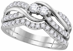 3/4 ctw Diamond Bridal Set--This 0.75carat total weight diamond Bridal Set expresses the harmony of union with an elegant intertwined two-stone diamond design and brilliant pave-set diamond accents in 14k white gold.