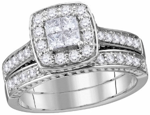 1.00 c.t.w Diamond Bridal Set in 14 Karat White Gold --Dramatic and dazzling, this diamond bridal set is just her style. Fashioned in 14K white gold, the engagement ring features a squared cluster of shimmering diamonds at its center. A squared frame of smaller round accent diamonds wraps the center cluster in a sparkling embrace, while smaller diamonds sparkle on the twisted split shank.