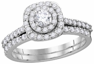 1 c.t.w Diamond Bridal Set with 0.20 c.t center round cut diamond in 14 Karat White Gold. Go ahead ask her
