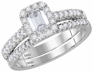 1 c.t.w Diamond Bridal Set with 0.50 c.t Central Emerald Cut Diamond in 14 Karat White Gold.