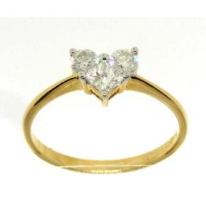 0.52CT ROUND AND PRINCESS CUT DIAMOND LADIES HEART RING -One of a kind piece for the special someone who will be impressed with beautiful engagement ring which has a base in 14 karat yellow gold and diamonds weighing upto 0.52 carats stay true to your words order one today ! Also available in white gold