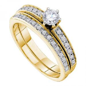 1/2 CTW Diamond Bridal Set with Round Center - A lone round cut diamond reigns supreme while additional sizzling round diamonds underscore what amounts to be a remarkable 14 karat Yellow gold engagement ring and wedding band display that should simply be flaunted at every opportunity.