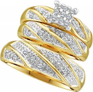 10k yellow gold 0.30 C.T.W. Diamond Cluster Trio Set. Three piece set of Diamond engagement ring and matching wedding bands.