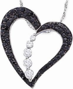 Diamond Ladies Heart Pendant.Make a sophisticated statement with this black and white diamond heart pendant. Crafted in 10 karat white gold, it holds radiant black and white diamonds totaling 0.50ctw.