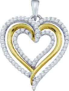 0.40CT DIAMOND HEART PENDANT WITH CHAIN -A heart shaped border of crisp clear diamonds outlines an impressive collection of  round diamonds 0.40 carat (ctw) in this fancy and heartfelt necklace crafted in 10 karat white gold TT. A beautiful piece at the right price .