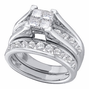 Diamond bridal set with princess cut and round diamonds. Engagement ring has a multi-stone invisible set princess cut center with round diamonds on the side and wedding band. Half carat total weight of Diamonds are set in 10 Karat white gold.
