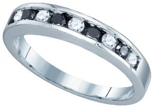 Whether you're looking for a unique wedding band, or simply an extra splash of color, this ring does the trick. Sparkling round-cut black diamond and white diamond  combine to be total weight of 0.24ct in a polished 10k white gold band.