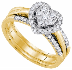 0.50CTW-DIA HEART BRIDAL SET-This 14kt yellow gold 0.50 cttw diamond bridal set is every girl's dream come true. The center of the bridal ring contains a heart made of diamonds that surrounds the center princess cut and round diamonds. The band is a simple, timeless design of channel set round diamonds.