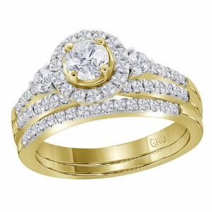 1.00 c.t.w Diamond Bridal Set with 0.37 c.t Center Round Cut Diamond in 14 Karat Yellow Gold. All of love's most precious moments shine through this romantic treasure. In 14K yellow gold, diamonds totaling 1.00 c.t.w create the bridal set of her dreams.To accompany your vows, a matching wedding band lined in diamonds completes this beautiful look