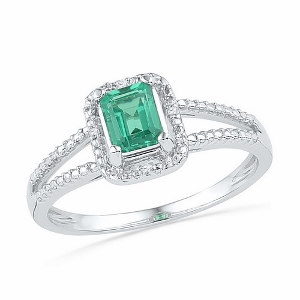 0.01 CTW Diamond and  1.50 CTW Lab Created Emerald Ring--  This beautiful lab created emerald and diamond ring created emerald surrounded by 0.01 carat  diamonds. Stones are set in 10 Karat White gold ring. Perfect gift for any occasion. Emerald is also birthstone for the month of May.