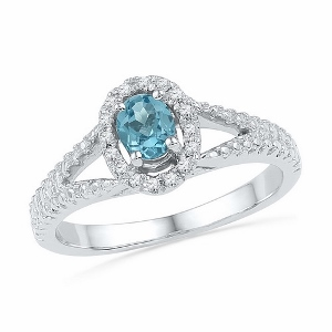 0.08 CTW Diamond and 0.45 CTW  Lab Created Blue Topaz Ring-- Blue topaz and diamond are set in 10 karat white gold. Blue topaz is also birthstone for the month of December. Ring makes a nice gift for any occasion.