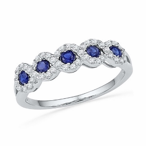 0.23 ctw Diamond with 0.30 ctw Lab Created Blue Sapphire Ring--Sapphire and diamonds are set in 10 karat White Gold. Sapphire is also birthstone for the month of September. Ring makes a nice gift for any occasion.