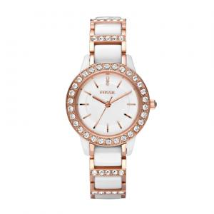 We love the pearly look of ceramic. Add some shine to your style with this glitzy, ceramic watch accented with warm rose gold-tones.Comes with an 11-year manufacturers' warranty and is packaged in a collectible tin. Water resistant up to 5 ATM.