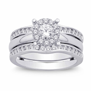 Crafted from 14K white gold, this dazzling ring enhancer features twinkling diamonds weighing approximately 0.78 c.t.w. Brighten her finger with this exquisite diamond enhancer Bridal. The center stone weight is 0.25ct.