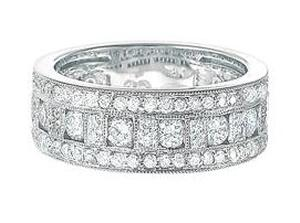 1.25 Carat Total Weight Diamond Band. White Gold Band has Round Diamonds                                      -                           Entirely ornate and fancy, this 14 karat white gold anniversary wedding ring emblazons  gleaming round and brilliant cut diamonds set in three luminous rows. Total diamond weight is 1.25 carat (ctw).