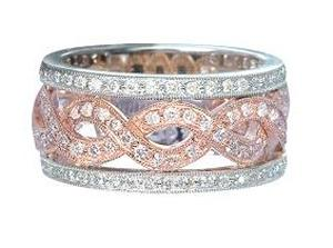 3/4 Carat Total Weight Diamond Band. White and Rose Gold Band has Round Diamonds                                                        -                                     Beautiful contours of sparkling diamonds whirl their way around an elegant foundation of glowing 14 karat  two tone gold in this anniversary wedding band that will absolutely melt her heart. Total diamond weight equals 3/4 carat (ctw).