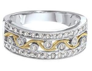 1/3 Carat Total Weight Diamond Band. White and Yellow Gold Band has Round Diamonds                                -                  Entirely fancy and intricate, this 14 karat two tone gold wedding band boasts a series of lovely  designs each imbued with lavish diamonds. Total diamond weight here equals 1/3 carat (ctw).