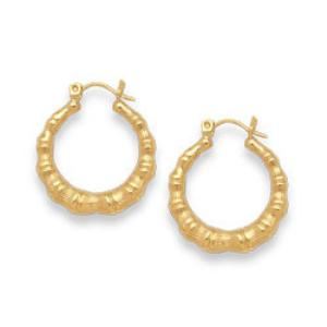 14 Karat Gold Earrings    -                            Creatively flowing sections of yellow gold crafted in 14 karat, these hoop earrings measuring just under one inch offer an original shape to a classic design.