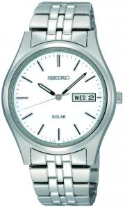 A Seiko watch with a sunny disposition. Stainless steel bracelet and round case. Silver dial features day/date window, logo and stick indices. Ten-month energy storage. Quick-start function and energy depletion warning. Solar quartz movement. Water resistant to 30 meters. Three-year limited warranty.