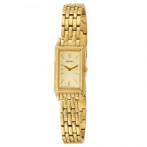 Elegant and classy, the Seiko Women's Dress Baguette Gold-Tone Stainless Steel Watch features a polished gold-tone stainless steel bezel and stylish rectangular case. Also featured are a matching gold-tone polished crown and a polished gold-tone stainless steel bracelet, which closes with a reliable push-button deployment clasp. This timepiece comes with gold-tone baton hour markers and hands that are easily visible against a gold-tone dial. Other features include a scratch-resistant Hardlex crystal and water resistance to 99 feet (30 meters).