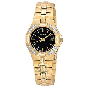 Seiko SXDA44 Women's watch features a polished finish gold plated stainless steel case with push and pull crown and encrusted with genuine Diamond on bezel. This beautiful watch also comes with high quality Japanese quartz movement, highly scratch resistant hardlex crystal, water resistant up to 30 meters, polished finish gold plated stainless steel bracelet with fold-over safety clasp and black dial with date display, gold tone hands and markers.