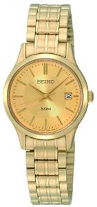 Seiko-Ladies Gold tone classic watch is 50 meter water resistant with date feature and Champagne dial.