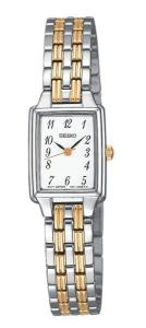 Add a touch of class to any ensemble with the Seiko two-tone stainless steel women's watch. The silver, square watch case measures a demure 0.7 inches wide. It has a white dial background with thin, gold-tone stick dial markers, baton hands (with second hand), and Arabic numerals at every hour. The stainless steel bracelet band is composed of polished silver and textured gold-tone pieces. Other features include Japanese quartz movement, a scratch-resistant sapphire crystal, and water resistance to 30 meters (99 feet).